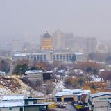 Clear Square The populous Salt Lake City downtown with a hazy sky background in winter. The historic Utah Stae Capital Building towers majestically over the royalty free stock images