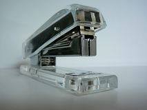 Clear stapler. A clear stapler on a table royalty free stock image