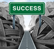 Clear Strategy. And financial planning road with a green highway sign and the word success as a business concept of winning solutions cutting through adversity Stock Photo