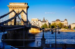 The Chain Bridge in Budapest, Hungary. A clear summer sky as the sun sets on the Chain Bridge in Budhapest, Hungary stock photos