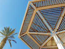 Clear sunny sky and beach umbrellas in Eilat resort; Israel stock photography