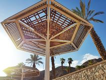 Clear sunny sky and beach umbrellas in Eilat resort; Israel stock image
