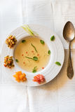 Clear tomato soup with chopped vegetables Stock Photo