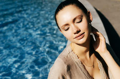 Clear toned skin woman enjoy summer vacation near pool,copyspace Stock Photography