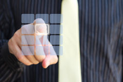 Clear touch screen keypad and hand. Business man pressing a button on clear keypad Royalty Free Stock Images