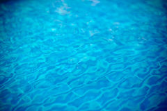 Clear transparent pool water defocused background Stock Photos