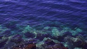 Clean sea water. Clear transparent sea water with stones stock video