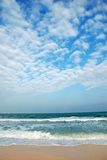 Clear Tropical Beach. Against beautiful Cloudscapes in Vertital Royalty Free Stock Image