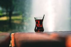 Clear Turkey Tea Glass With Tea on Brown Wooden Table Stock Images
