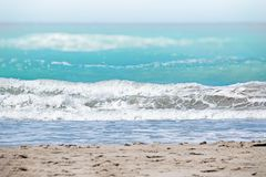 The clear turquoise sea of the Atlantic ocean on which are white waves. Above it is the blue sky. It`s in the Caribbean royalty free stock photos