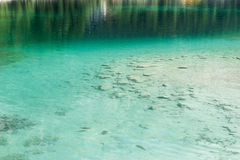 Clear turquoise water with stones Stock Images