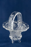 Clear Vase On Blue. An elegant clear vase with intricate design etched in Stock Photo