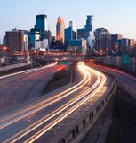 Interstate Traffic Moving Metro Highway Minneapolis Minnesota. Clear view sunset light infrastructure roads buildings in downtown inner city Minneapolis MN Royalty Free Stock Photo