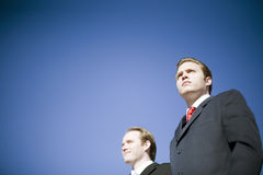 Clear Vision. Two businessmen wearing suits posing with determined vision pose Royalty Free Stock Images