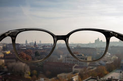 Clear vision through glasses. Clear vision of city landscape through glasses Royalty Free Stock Photo