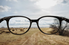 Clear vision through glasses. Clear vision of desert landscape through glasses Stock Image