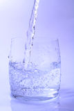 Clear water. Fresh water pouring into glass royalty free stock images
