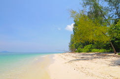 Clear water and beach in the blue sky Royalty Free Stock Images