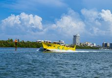 Clear water beach florida skyline and speed boat Clearwater stock photo