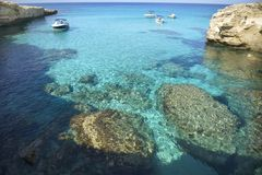 Clear water in the blue lagoon in Cyprus. Blue Lagoon, Transparent water of the Mediterranean sea, the Picturesque beaches of Cyprus Stock Images