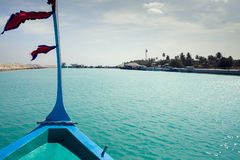 Clear water and blue sky, view from boat, Maldives.  Stock Photo