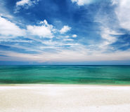 Clear water and blue sky. White sand beach Stock Photos