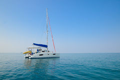 Clear water blue sky and yacht. Beach in Krabi province, Thailan Royalty Free Stock Photo