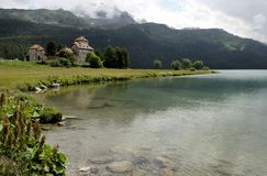 Clear water and castle, engadin Stock Images