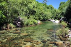 Clear water at Cavado River - 2. Water stream with a small waterfall. Clean, transparent, pristine water near a hydroelectric power station in Cavado River stock photos