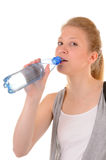 Clear water drinkind. Nice girl in casual style is drinking clear water from plastic bottle stock photo