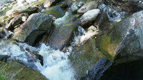 Clear water flowing over stones stock video