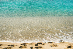Clear water and footprints at Cleopatra beach, Alanya, Turkey Royalty Free Stock Photo