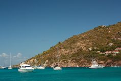 Clear water, island, boats and yachts Royalty Free Stock Image