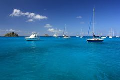 Clear water, island, boats and yachts Royalty Free Stock Photography