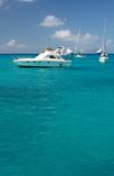 Clear water, island, boats and yachts Royalty Free Stock Images