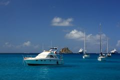 Clear water, island, yachts and boats Royalty Free Stock Photo