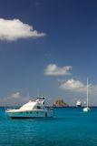 Clear water, island, yachts and boats Royalty Free Stock Images