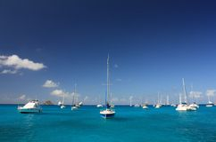 Clear water, island, yachts and boats Royalty Free Stock Image