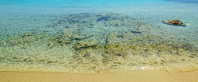 Clear water in Le Bombarde beach Stock Photo