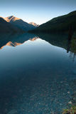 Clear water of a mountain lake at sunset Royalty Free Stock Images