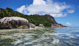 Clear water, mountains and palm trees, Seychelles Royalty Free Stock Photos