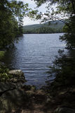 Clear water of Mountainview Lake, summertime, Sunapee, New Hamps Royalty Free Stock Photography