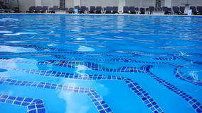 Clear water in a outdoor swimming pool in the club. Clear water in a outdoor swimming pool in the night club stock video footage