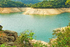 The clear water of reservoir and aqueous rocks Stock Images