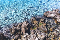 Clear water on rocky coast of Adriatic Sea in Dubrovnik, Croatia. Reflections on clear sea water stock photo