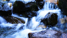 Clear Water Rushing Through Stones royalty free stock photos