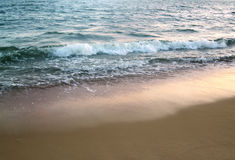 Clear Water and Sand beach background Stock Photos