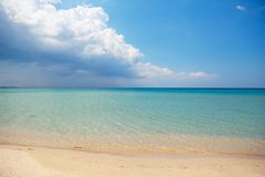 Clear water in the sea, Sunny day, horizon. clear sea water, sandy beach in Sunny weather. with big clouds on the horizon. The concept of rest Stock Photo
