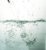 Clear water splash Stock Images