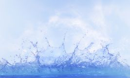 Clear water splashing against blue sky ,white day light cloud stock photo